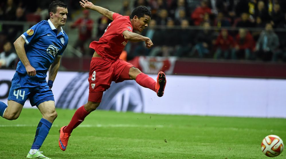Carlos Bacca of Sevilla FC shoots to score his side's third goal during the UEFA Europa League final against FC Dnipro Dnipropetrovsk