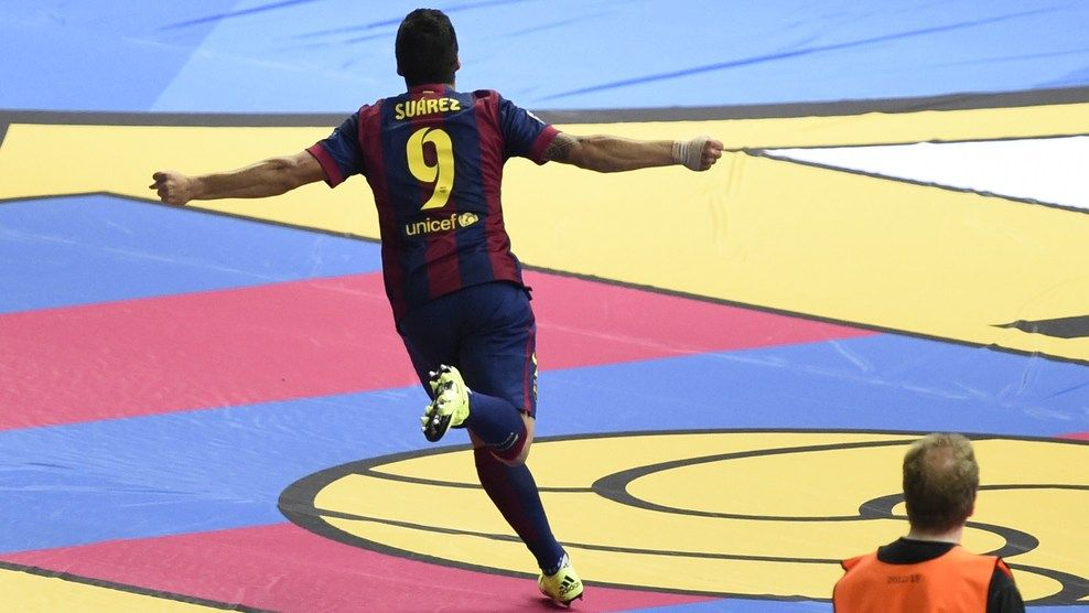 Barcelona's Uruguayan forward Luis Suarez celebrates after scoring the 1-2 during the UEFA Champions League Final football match between Juventus and FC Barcelona at the Olympic Stadium in Berlin on June 6, 2015.     AFP PHOTO / ODD ANDERSEN        (Photo credit should read ODD ANDERSEN/AFP/Getty Images)