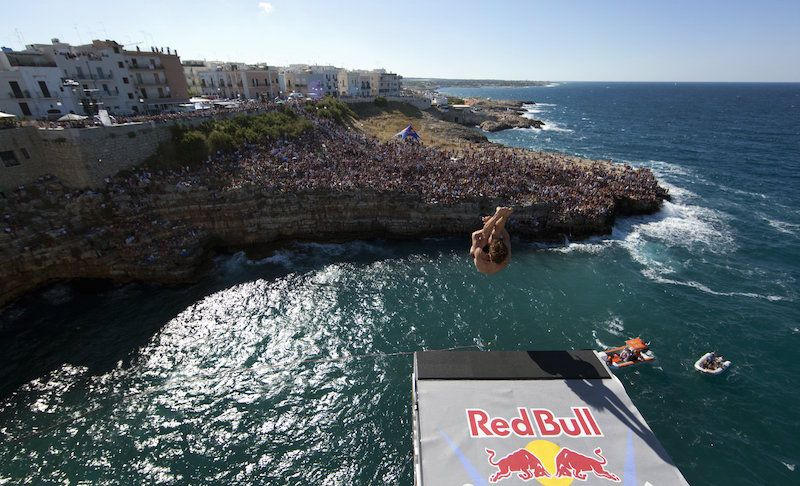 Gary Hunt of England dives from the 26.5 metre platform during the fourth round of the 2010 Red Bull Cliff Diving World Series, Poligano a Mare, Italy on August 8; 2010.  // Romina Amato/Red Bull Cliff Diving // P-20120217-77728 // Usage for editorial use only // Please go to www.redbullcontentpool.com for further information. //
