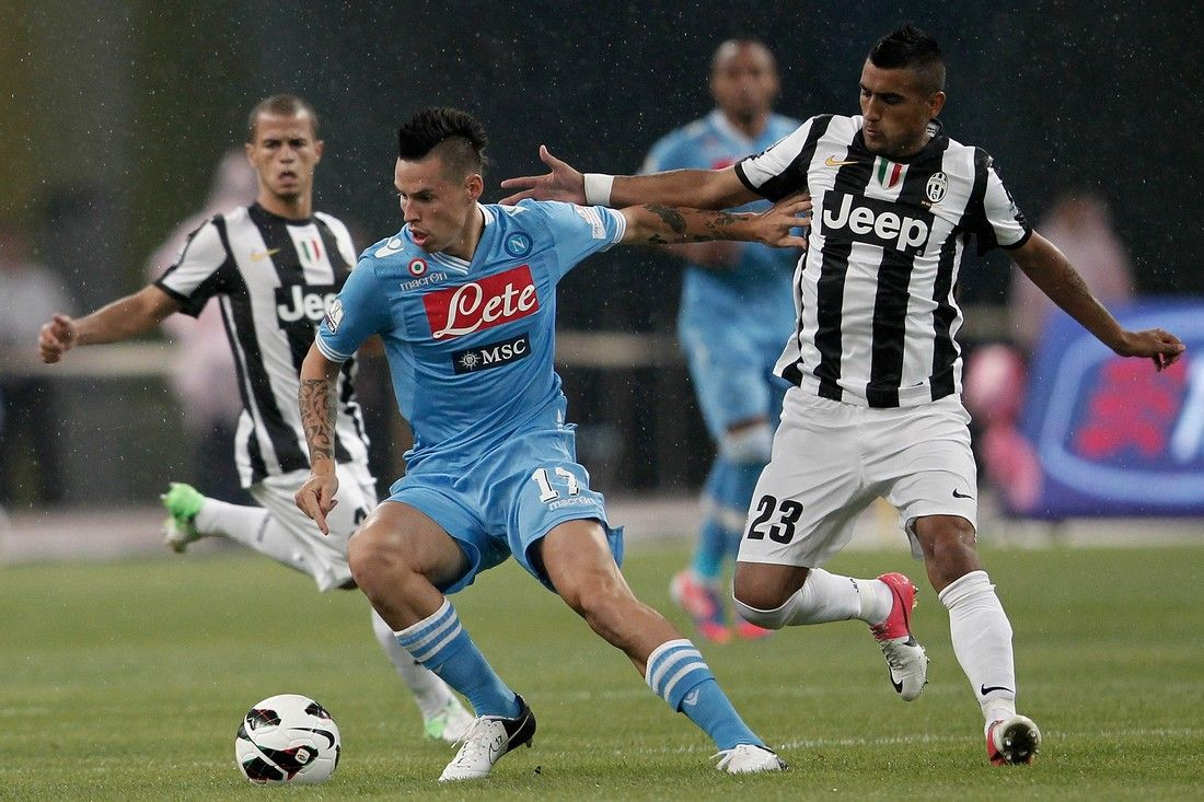 BEIJING, CHINA - AUGUST 11: Marek Hamsik (#17) of SSC Napoli challenges Arturo Vidal (R) of Juventus FC during the Italian Super Cup 2012 match at China's National Stadium on August 11, 2012 in Beijing, China.  (Photo by Lintao Zhang/Getty Images)