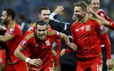Wales' Gareth Bale (L) and teammates celebrate after they qualified for Euro 2016 following their qualifying soccer match against Bosnia in Zenica October 10, 2015. REUTERS/Dado Ruvic