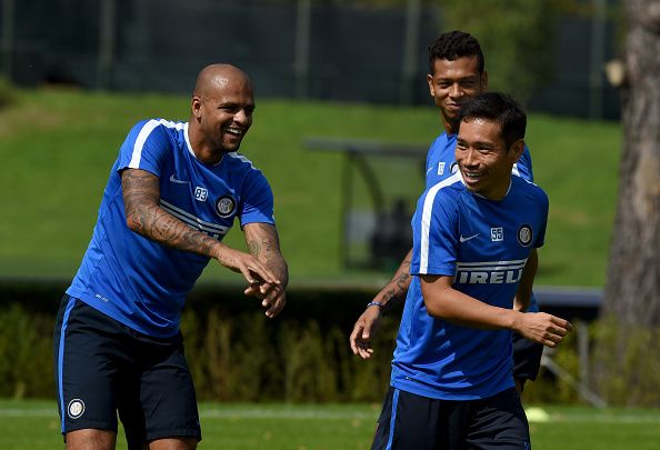 COMO, ITALY - SEPTEMBER 18:   Felipe Melo (L) and Yuto Nagatomo of FC Internazionale smile during a training session at the club's training ground at Appiano Gentile on September 18, 2015 in Como, Italy.  (Photo by Claudio Villa - Inter/Inter via Getty Images)