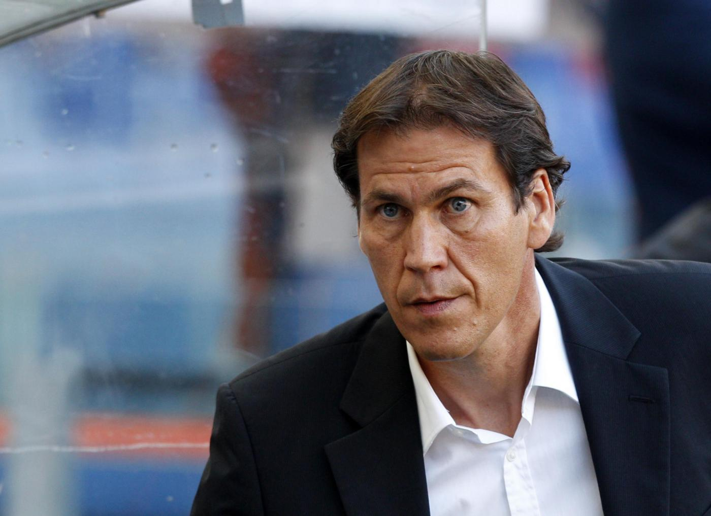 AS Roma coach Rudi Garcia, of France, waits for the kick-off of a Serie A soccer match between AS Roma and Hellas Verona, at Rome's Olympic stadium, Sunday, Sept. 1, 2013. (AP Photo/Riccardo De Luca)