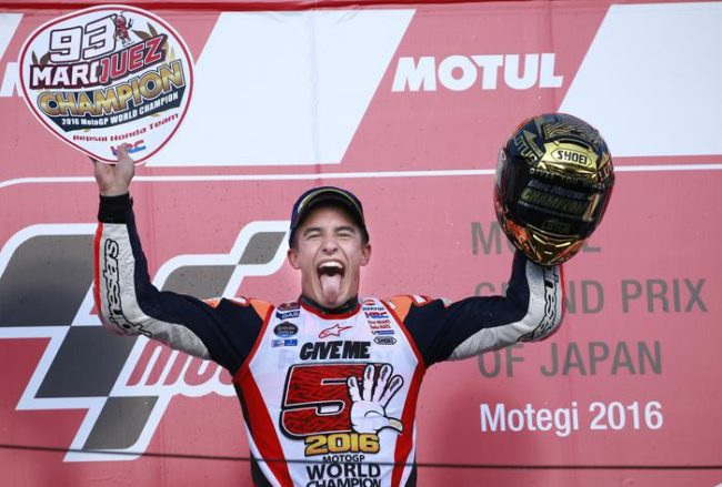 Spain's Marc Marquez celebrates during the awarding ceremony of the MotoGP Japanese Motorcycle Grand Prix at the Twin Ring Motegi circuit in Motegi, north of Tokyo, Sunday, Oct. 16, 2016. Marquez won the MotoGP of Japan on Sunday to secure the 2016 title with three races remaining. (ANSA/AP Photo/Shizuo Kambayashi) [CopyrightNotice: Copyright 2016 The Associated Press. All rights reserved.]