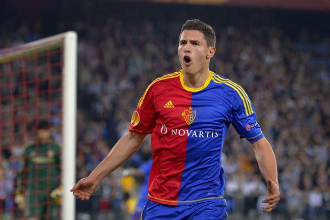 FC Basel's defender Fabian Schaer celebrates after scoring a penalty kick during an UEFA Europa League first leg semi-final football match between Basel and Chelsea at the St Jakob stadium in Basel on April 25, 2013.  AFP PHOTO / FABRICE COFFRINI