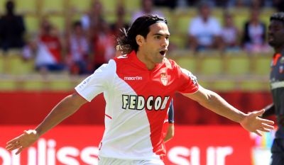 Monaco's Colombian forward Radamel Falcao celebrates after scoring a goal from the penalty spot during the French L1 football match between AS Monaco and FC Lorient at the Louis II Stadium in Monaco on September 15, 2013. AFP PHOTO / JEAN CHRISTOPHE MAGNENET