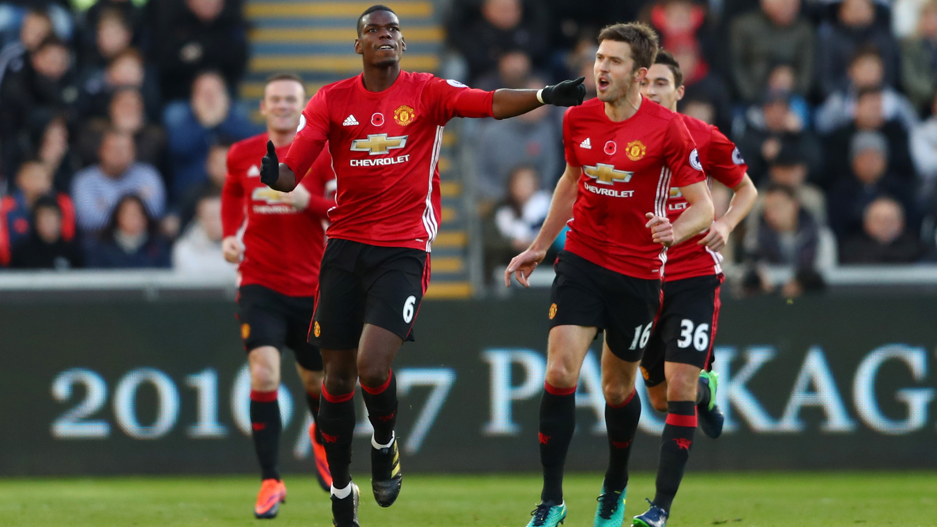 SWANSEA, WALES - NOVEMBER 06: Paul Pogba of Manchester United celebrates scoring his sides first goal with Michael Carrick during the Premier League match between Swansea City and Manchester United at Liberty Stadium on November 6, 2016 in Swansea, Wales.  (Photo by Michael Steele/Getty Images)