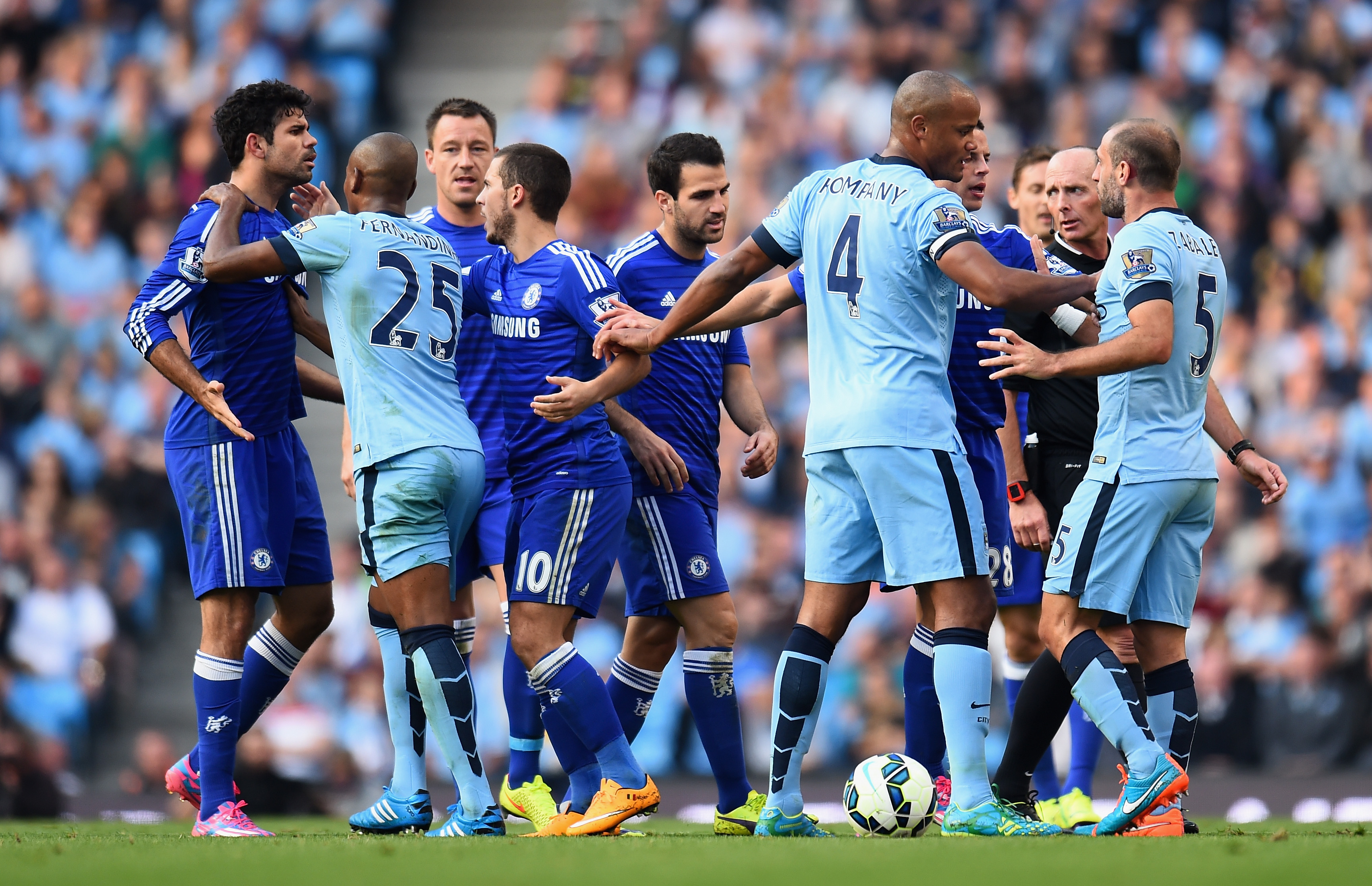 MANCHESTER, ENGLAND - SEPTEMBER 21:   Pablo Zabaleta of Manchester City is separated from Diego Costa of Chelsea by his team-mates during the Barclays Premier League match between Manchester City and Chelsea at the Etihad Stadium on September 21, 2014 in Manchester, England.  (Photo by Shaun Botterill/Getty Images)