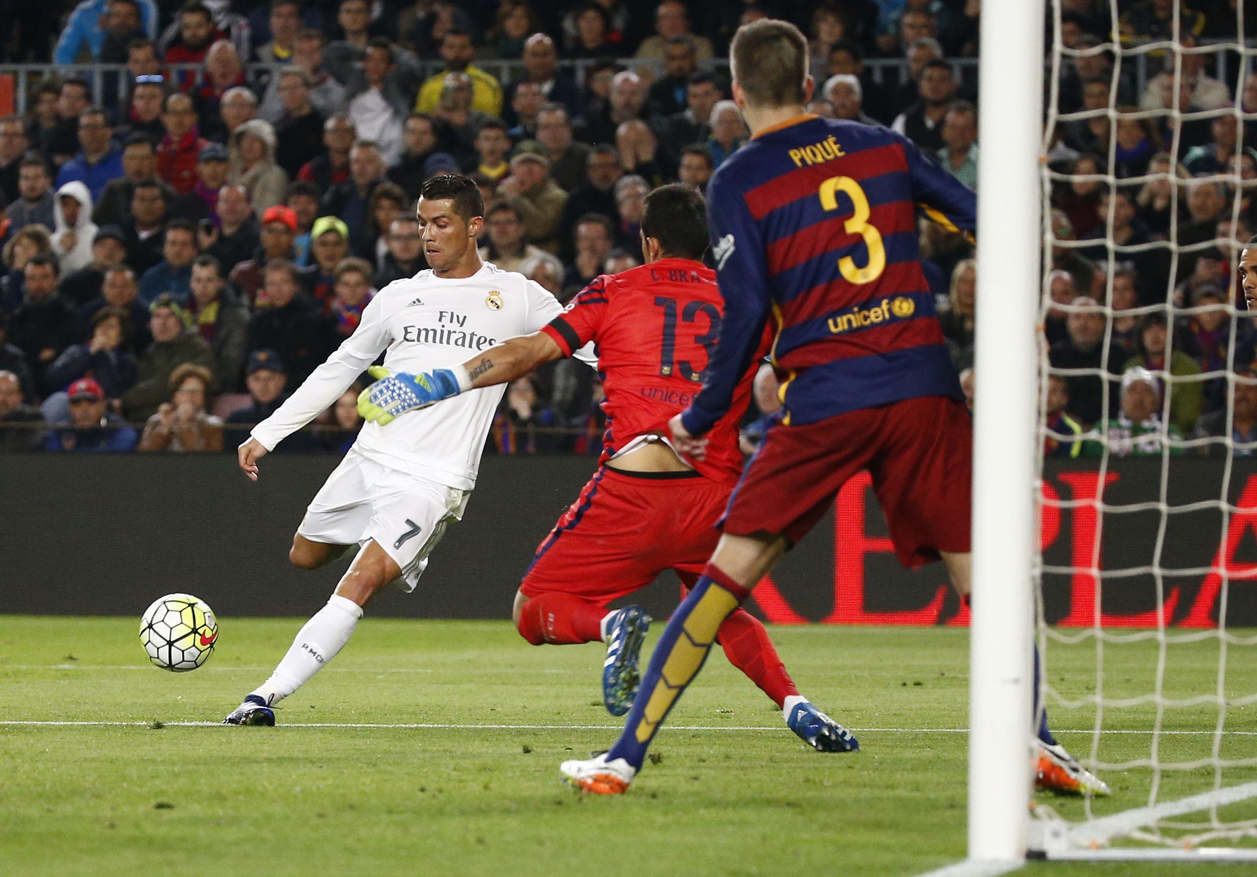 Football Soccer - FC Barcelona v Real Madrid - La Liga - Camp Nou, Barcelona - 2/4/16 Real Madrid's Cristiano Ronaldo scores their second goal Reuters / Juan Medina Livepic EDITORIAL USE ONLY.