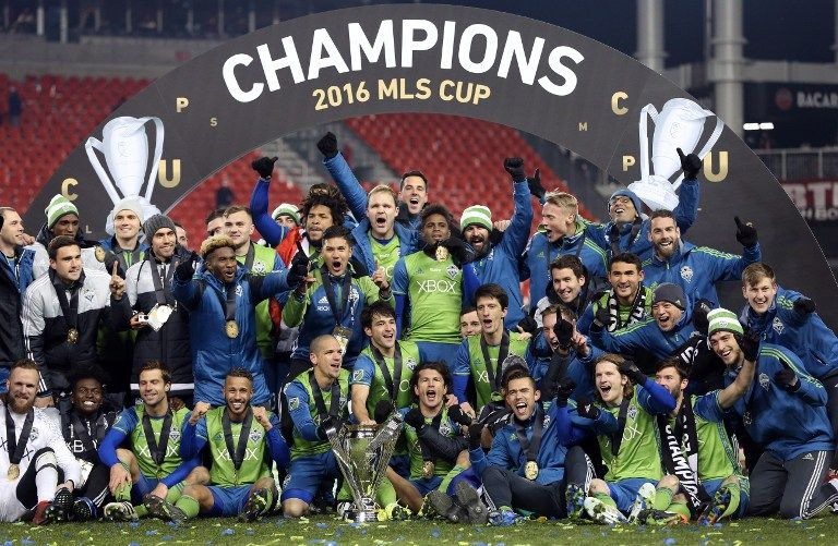 Seattle Sounders celebrate their MLS Cup final victory over Toronto FC at BMO Field on December 10, 2016 in Toronto. / AFP PHOTO / Cole Burston