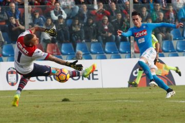Diego Falcinelli of Crotone competes for the ball with Kalidou Koulibaly of Napoli during the Serie A match between FC Crotone and SSC Napoli at Stadio Comunale Ezio Scida on October 23, 2016 in Crotone, Italy.