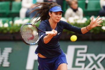 PARIS, FRANCE - MAY 24:  Oceane Dodin of France plays a forehand during the Women's Singles first round match against Ana Ivanovic of Serbia on day three of the 2016 French Open at Roland Garros on May 24, 2016 in Paris, France.  (Photo by Dennis Grombkowski/Getty Images)