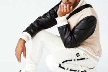 Hamilton mentre presenta una nuova linea d'abbigliamento.  Fonte: Hamilton Facebook